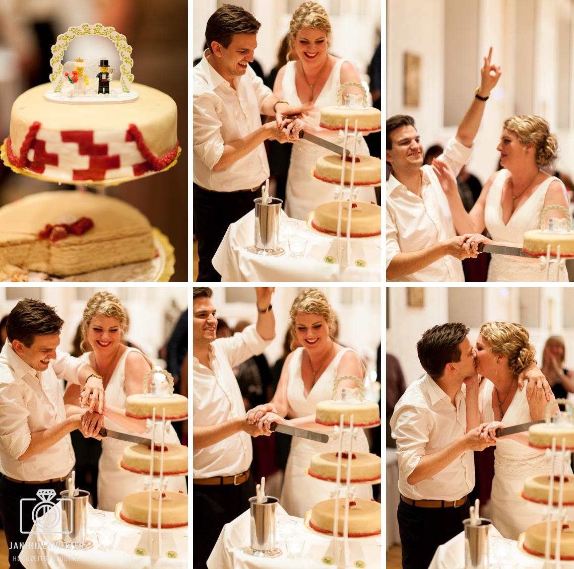 Hochzeitspaar-Hochzeitstorte-Schlosshotel-Weilburg-Anschnitt-lustig