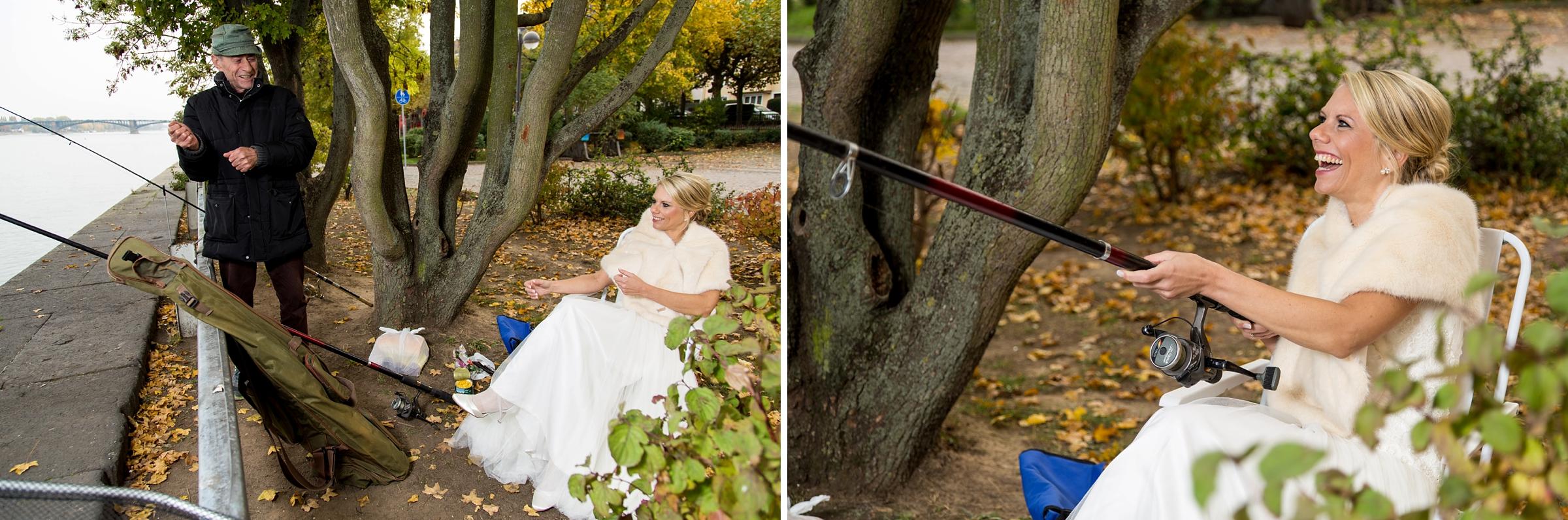 Hochzeitsfotograf-Mainz-lustige-Braut-angelt-am-Rhein