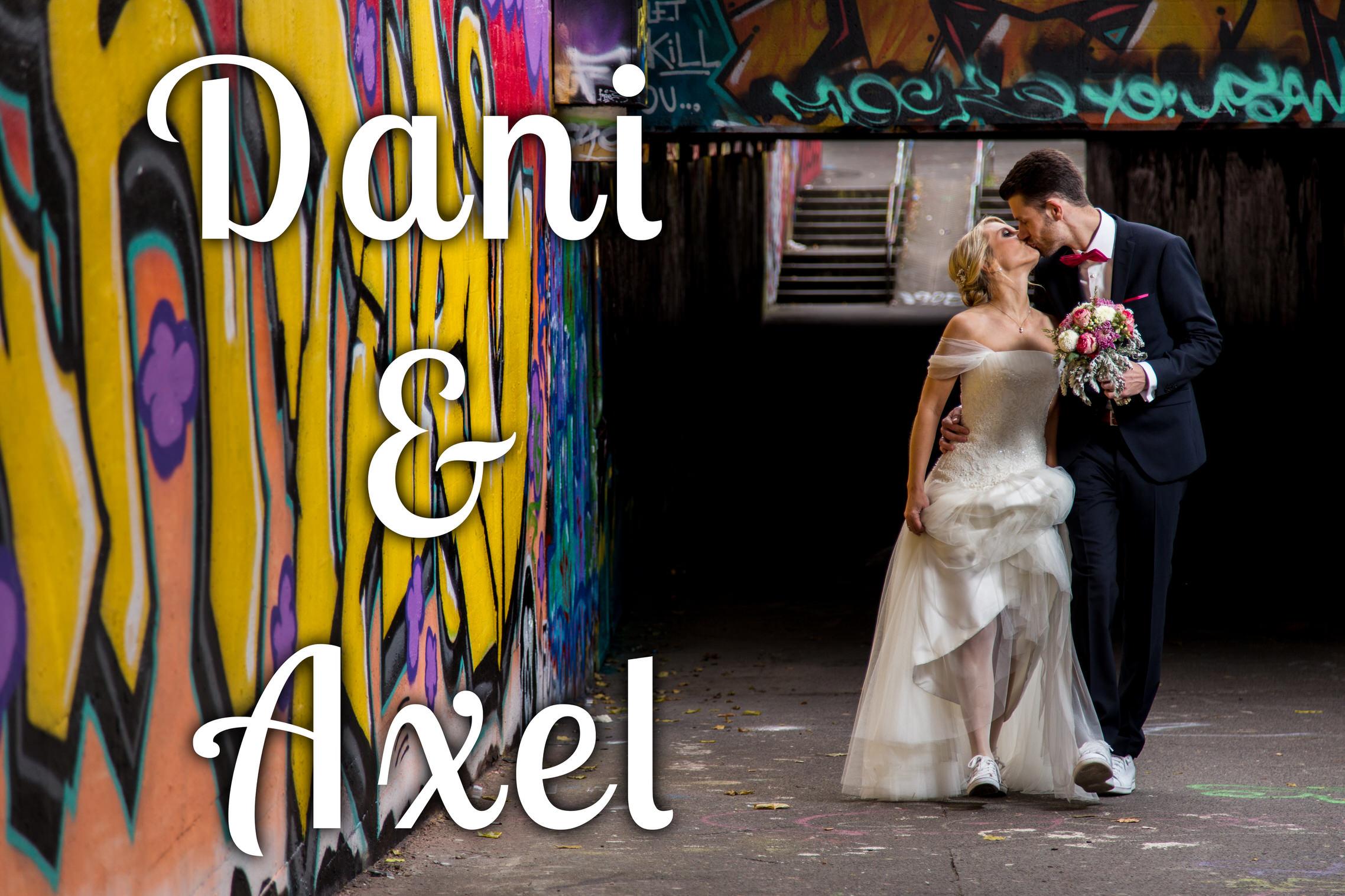 Hochzeitspaar-vor-Graffiti-Wand-abgefahrenes-Hochzeitsbild