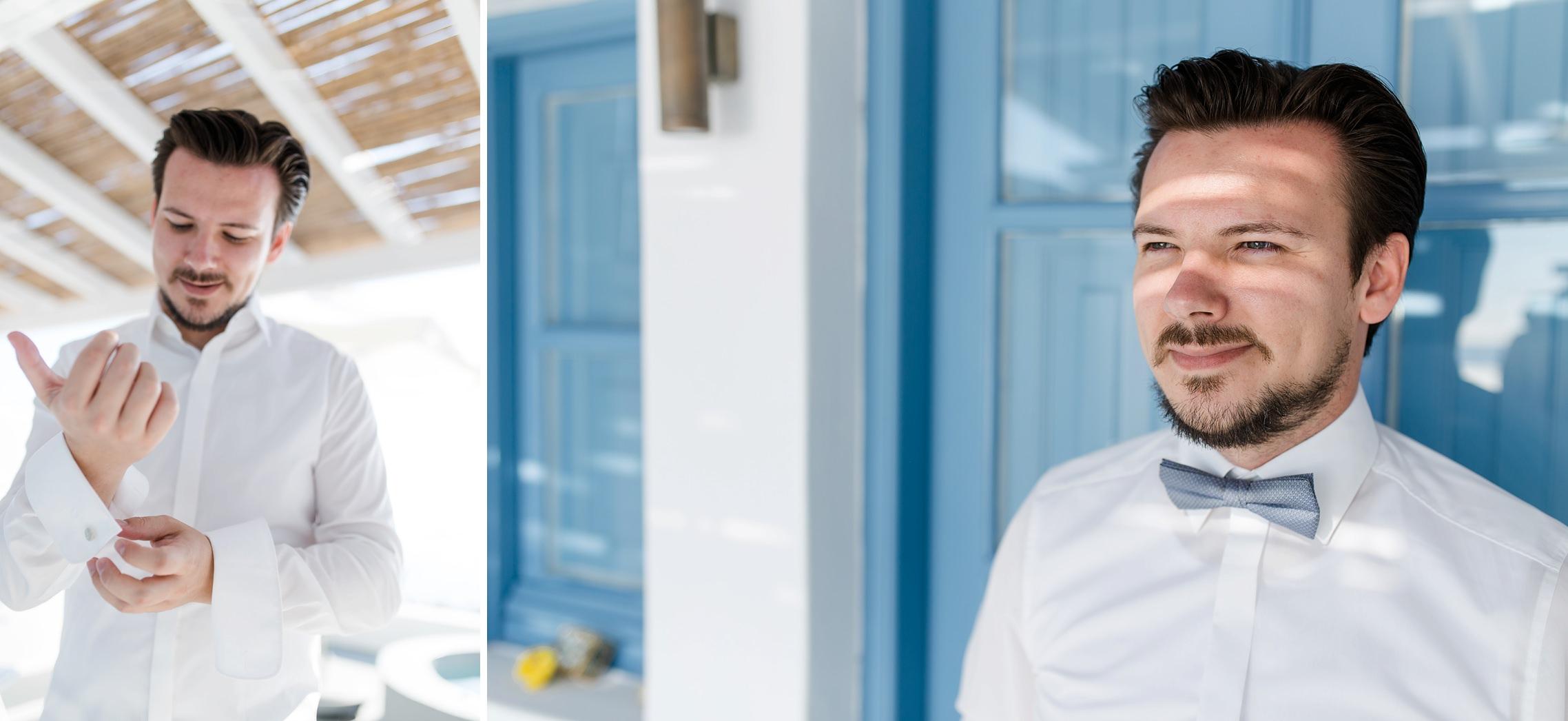 Der Bräutigam legt sich beim Getting Ready die Manschettenknöpfe auf Santorini an