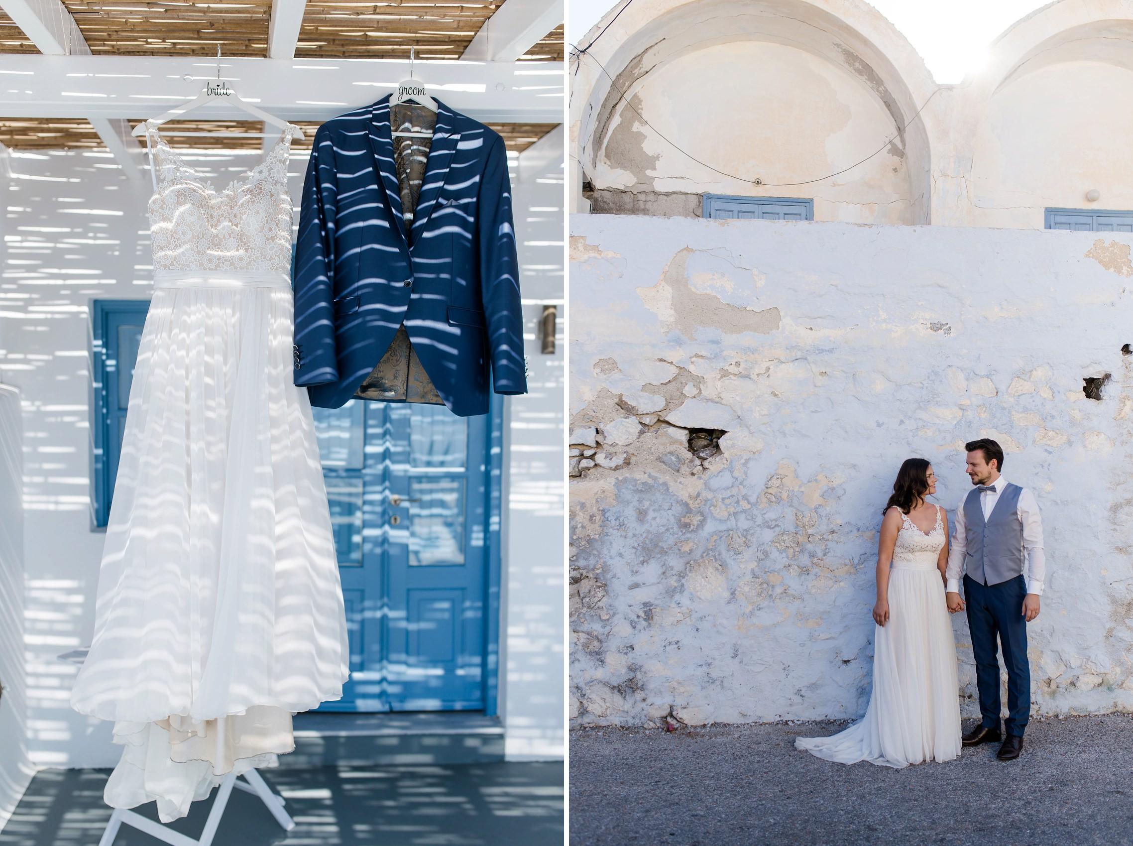 After-Wedding-Shooting Santorini: Brautpaar steht vor einer alten Mauer - der Putz bröckelt schon ab. Brautkleid und Anzug des Bräutigams hängen unter dem Strohdach.