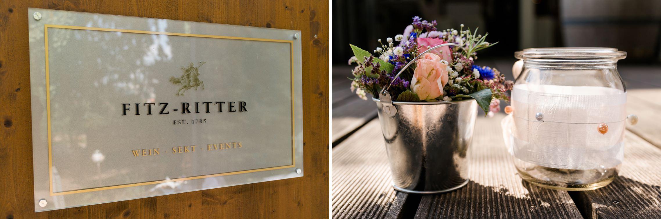 Detailaufnahme Schild Weingut Fitz-Ritter sowie der Blumendeko.