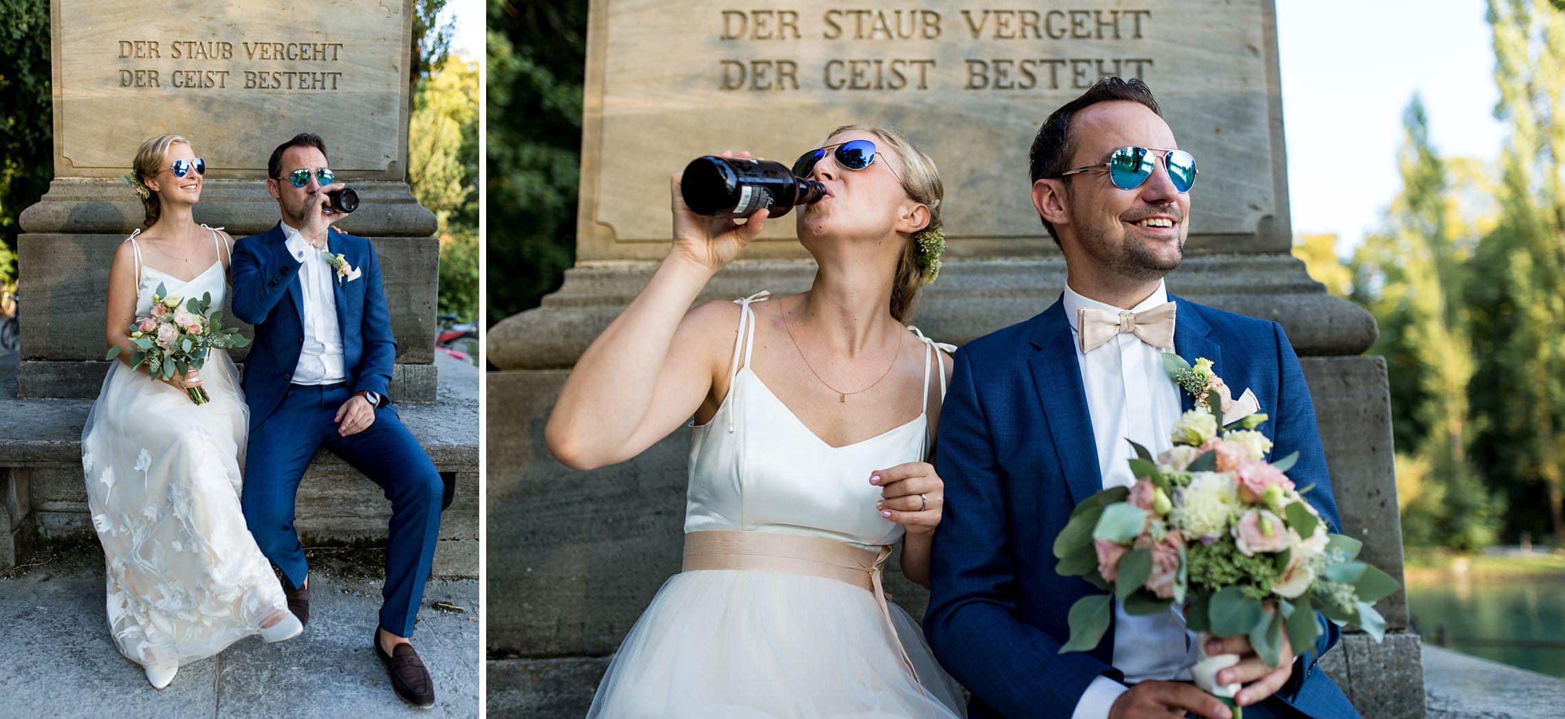 Lustiges Brautpaar mit Sonnenbrillen und Bier beim Hochzeits-Shooting
